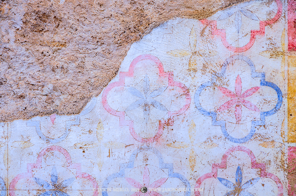 Historic painted plaster finish on Mission San José in San Antonio, Texas.