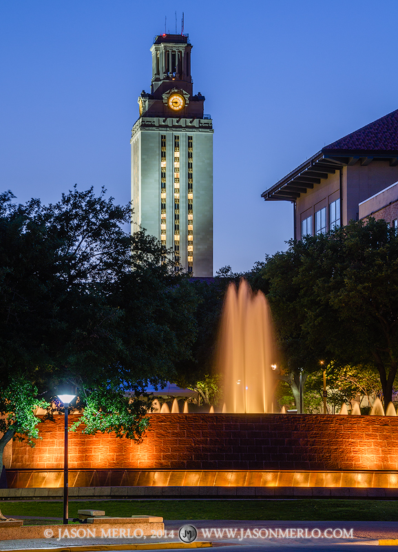 The East Mall Fountain and the Tower at dusk with the number 14 displayed commemorating the 2014 Spring Commencement at the University...