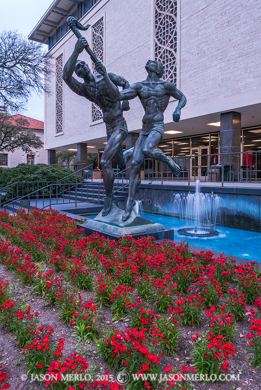 Flawn Academic Center and the Torchbearers statue at the University of Texas in Austin, Texas.