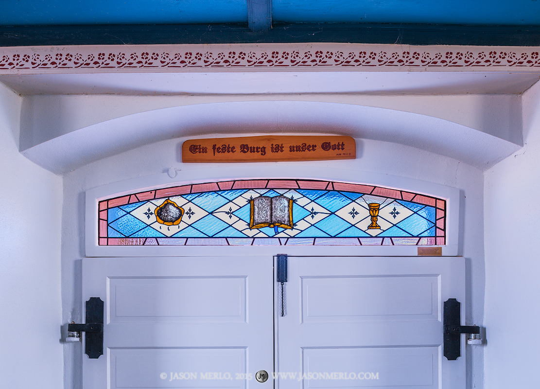 A stained glass window over the chapel doors at St. Paul Lutheran Church in Serbin, one of the Painted Churches of Texas. The...