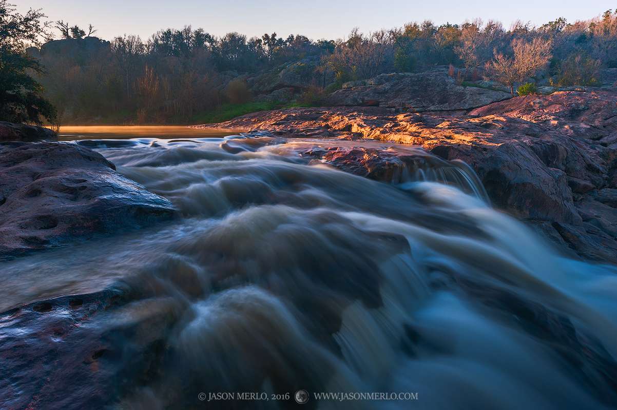 A waterfall on Spring Creek flows strongly after recent rains at Inks Lake State Park in Burnet County in the Llano Uplift of...