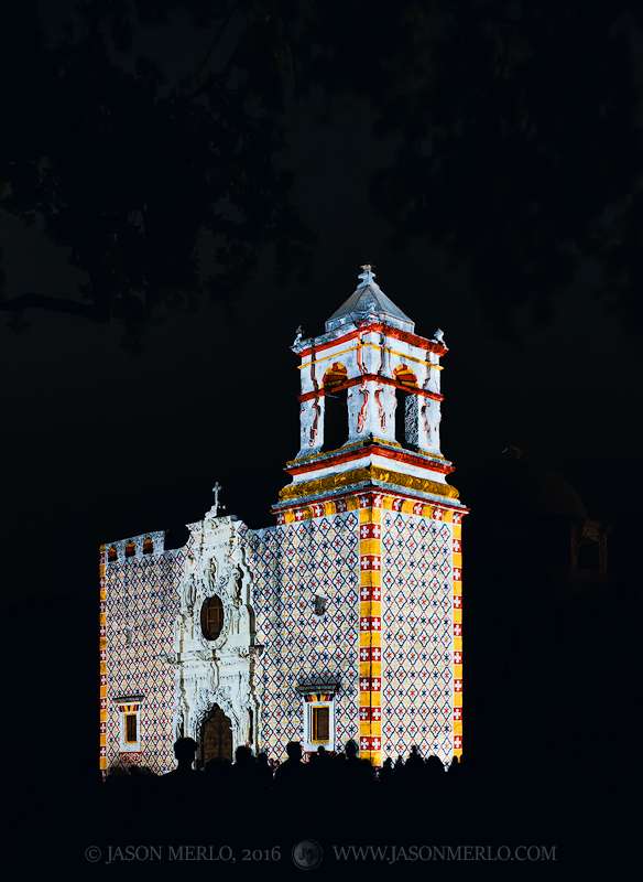 Historic patterns projected on the chapel façade during the Restored by Light program at Mission San José in San Antonio, Texas...