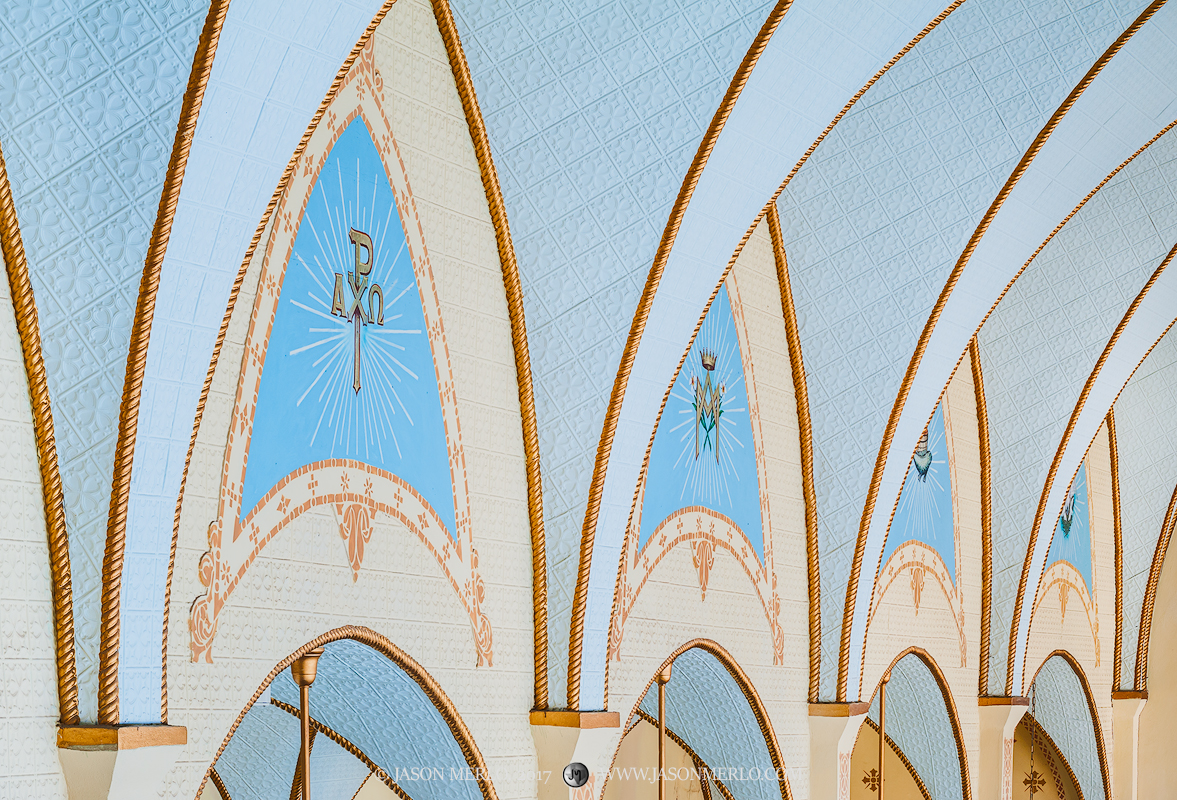 Painted arches at Our Lady of Grace Catholic Church in La Coste, one of the Painted Churches of Texas.