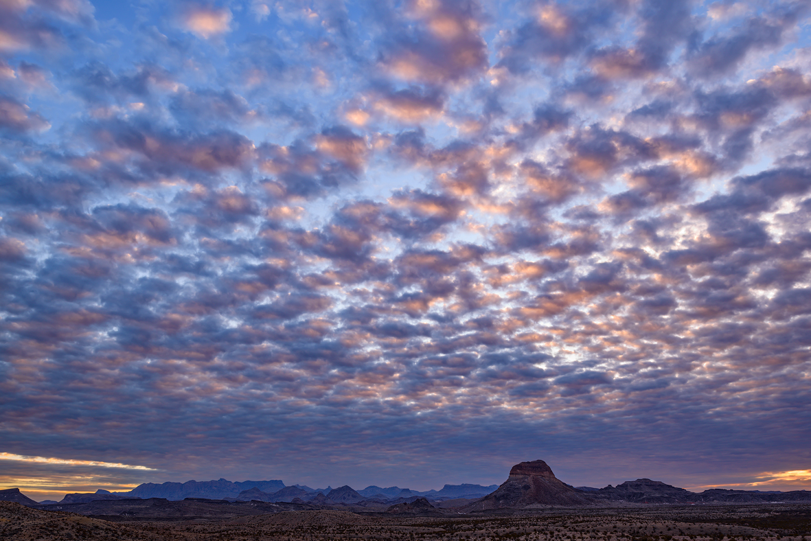 Sunrise clouds over the Chisos Mountains in Big Bend National Park in Brewster County in West Texas.