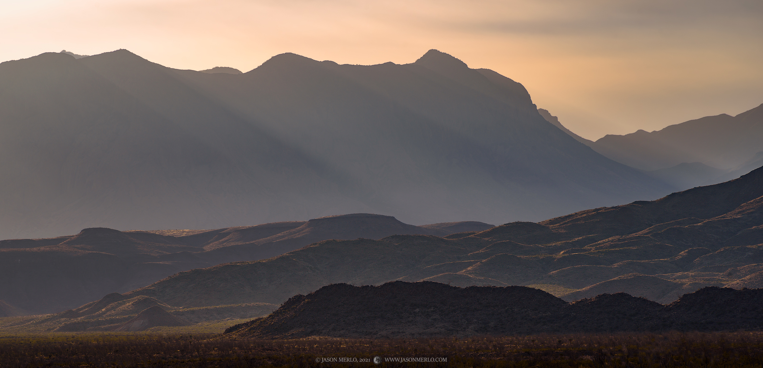 Mid-morning sunlight shining over the Chisos Mountains in Big Bend National Park in Brewster County in West Texas.